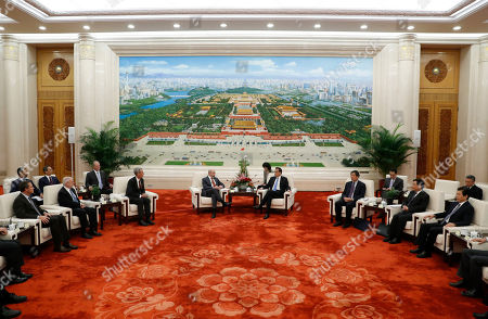 Chairman of the US-China Business Council Evan Greenberg (L) attends a meeting with Chinese Premier Li Keqiang (R) at the Great Hall of the People in Beijing, China, 17 October 2019.