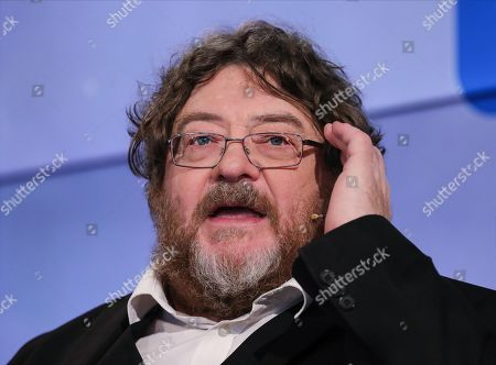 Stock Image of Scottish author John Burnside speaks during an interview at Frankfurt Book Fair 2019 in Frankfurt Main, Germany, 17 October, 2019. The 71st edition of the international Frankfurt Book Fair, described as the world's most important fair for the print and digital content business, runs from 16 to 20 October and gathers authors, writers and celebrities from all over the world.