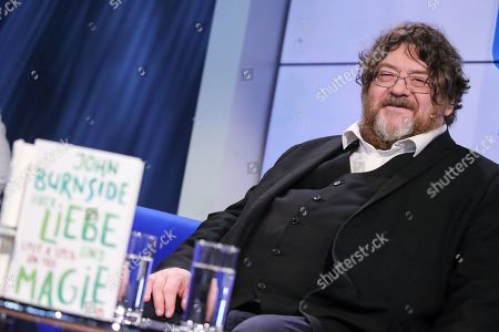 Stock Photo of Scottish author John Burnside speaks during an interview at Frankfurt Book Fair 2019 in Frankfurt Main, Germany, 17 October, 2019. The 71st edition of the international Frankfurt Book Fair, described as the world's most important fair for the print and digital content business, runs from 16 to 20 October and gathers authors, writers and celebrities from all over the world.