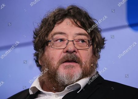 Scottish author John Burnside speaks during an interview at Frankfurt Book Fair 2019 in Frankfurt Main, Germany, 17 October, 2019. The 71st edition of the international Frankfurt Book Fair, described as the world's most important fair for the print and digital content business, runs from 16 to 20 October and gathers authors, writers and celebrities from all over the world.