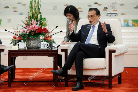 POOL PHOTO. Chinese Premier Li Keqiang speaks with Chairman of the U.S.-China Business Council Evan Greenberg, at the Great Hall of the People in Beijing