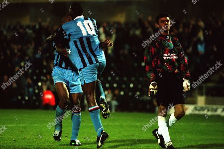 Wycombe's John Williams (No 10) leaps into the arms of Miquel Desouza to celebrate scoring their second goal as Reading goalkeeper, Borislav Mihaylov walks back towards his goal during Wycombe Wanderers vs Reading Coca-Cola Cup Football at Adams Park on 3rd September 1996