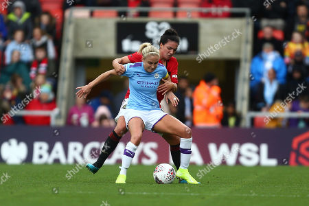 Jessica Sigsworth of Manchester United and Steph Houghton of Manchester City