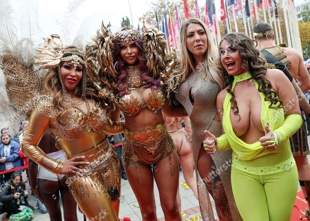 German actress Micaela Schaefer (2-L) and TV moderator Patricia Blanco (L) pose with some participants in the opening of the Venus Erotic Trade Fair in Berlin, Germany, 17 October 2019. Venus Berlin is among the largest international erotic trade fairs, with more than 250 exhibitions from 40 countries and 30,000 visitors.