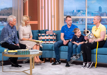 Stock Photo of Phillip Schofield, Holly Willoughby, John Robinson, Charlie Robinson and Suzy Emsden with Alfie the Pug