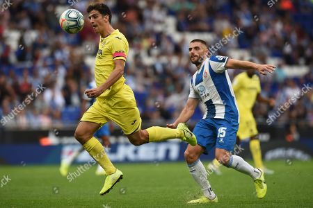 Gerard Moreno of Villarreal CF and David Lopez of RCD Espanyol