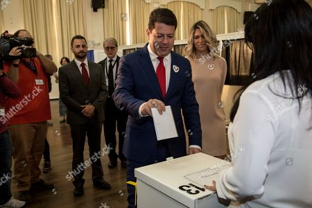 Chief Minister of Gibraltar Fabian Picardo places his vote during general elections in Gibraltar, . An election for Gibraltar's 17-seat parliament is taking place Thursday under a cloud of uncertainty about what Brexit will bring for this British territory on Spain's southern tip