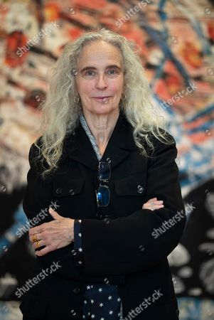 US artist Kiki Smith poses next to her artwork during the press visit of her exhibition 'Kiki Smith' held at the Monnaie de Paris, in Paris, France, 17 October 2019. The exhibition runs from 18 October to 09 February 2020.