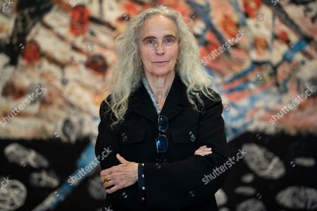Stock Picture of US artist Kiki Smith poses next to her artwork during the press visit of her exhibition 'Kiki Smith' held at the Monnaie de Paris, in Paris, France, 17 October 2019. The exhibition runs from 18 October to 09 February 2020.