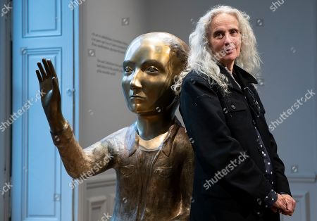 Stock Photo of US artist Kiki Smith poses next to her artwork entitled 'Annunciation' during the press visit of her exhibition 'Kiki Smith' held at the Monnaie de Paris, in Paris, France, 17 October 2019. The exhibition runs from 18 October to 09 February 2020.