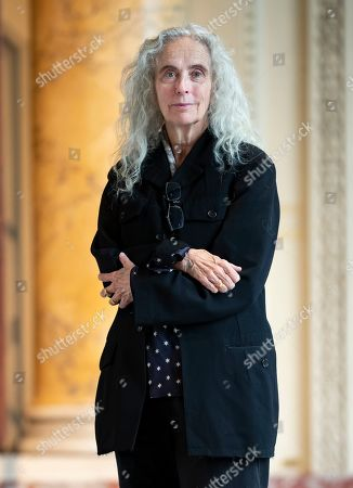 Stock Image of US artist Kiki Smith poses next to her artwork during the press visit of her exhibition 'Kiki Smith' held at the Monnaie de Paris, in Paris, France, 17 October 2019. The exhibition runs from 18 October to 09 February 2020.