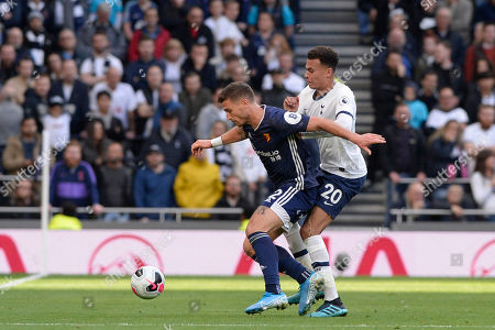 Dele Alli of Tottenham Hotspur and Daryl Janmaat of Watford in action during the Premier League match between Tottenham Hotspur and Watford at The Tottenham Hotspur Stadium in London, UK - 19th October 2019