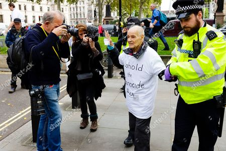 Stock Image of 91 year-old Extinction Rebellion protester Eric Levy is photographed as he is arrested after glueing himself to his fellow protesters outside the Supreme Court.