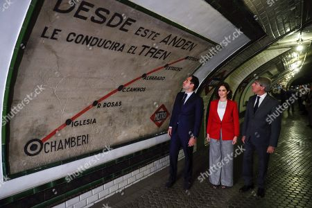 Madrid's regional President, Isabel Diaz Ayuso (C), Madrid's regional President, Ignacio Aguado (L), and Transport regional Minister, Angel Garrido (R), visit one of the oldest Metro stations on occasion of the 100th anniversary of the city's subway. Madrid's Metro was opened 17 October 1919 with a 3.5 km network and 192 employees. A hundred years later, the capital's subway covers 294 km and has almost 7,000 employees.