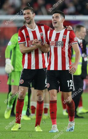 Stock Photo of Chris Basham of Sheffield Utd and John Egan of Sheffield Utd celebrate at the end of the match