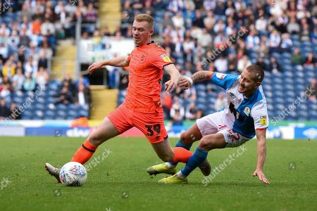19th October 2019, Ewood Park, Blackburn, England; Sky Bet Championship, Blackburn Rovers v Huddersfield Town : Lewis O'Brien (39) of Huddersfield Town is fouled by Lewis Holtby (22) of Blackburn Rovers Credit: Simon Whitehead/News Images