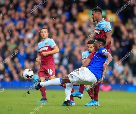19th October 2019, Goodison Park, Liverpool, England; Premier League, Everton v West Ham United : Yerry Mina (13) of Everton clears the ball under pressure from Sebastian Haller (22) of West Ham United