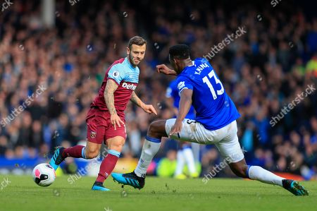 Stock Image of 19th October 2019, Goodison Park, Liverpool, England; Premier League, Everton v West Ham United : Jack Wilshire (19) of West Ham United passes the ball beyond Yerry Mina (13) of Everton