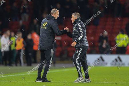 21st October 2019, Bramall Lane, Sheffield, England; Premier League, Sheffield United v Arsenal : Chris Wilder manager of Sheffield United shakes hands with his number 2 Alan Knill  as Sheffield United win 1-0 and take three points  Credit: Mark Cosgrove/News Images
