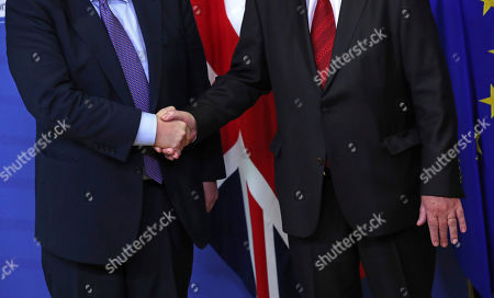 British Prime Minister Boris Johnson, left, shakes hands with European Commission President Jean-Claude Juncker during a press point at EU headquarters in Brussels, . Britain and the European Union reached a new tentative Brexit deal on Thursday, hoping to finally escape the acrimony, divisions and frustration of their three-year divorce battle
