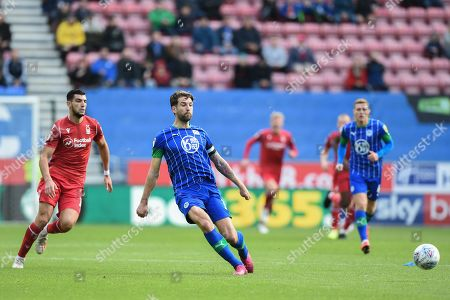 20th October 2019, DW Stadium, Wigan, England; Sky Bet Championship, Wigan Athletic v Nottingham Forest : Charlie Mulgrew (16) of Wigan Athletic passes back to the goal under pressure from Rafa Mir (14) of Nottingham Forest 