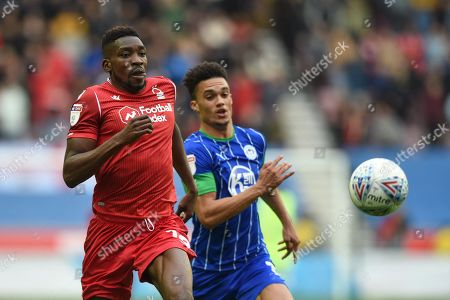 20th October 2019, DW Stadium, Wigan, England; Sky Bet Championship, Wigan Athletic v Nottingham Forest : Sammy Ameobi (19) of Nottingham Forest and Charlie Mulgrew (16) of Wigan Athletic chase down the ball