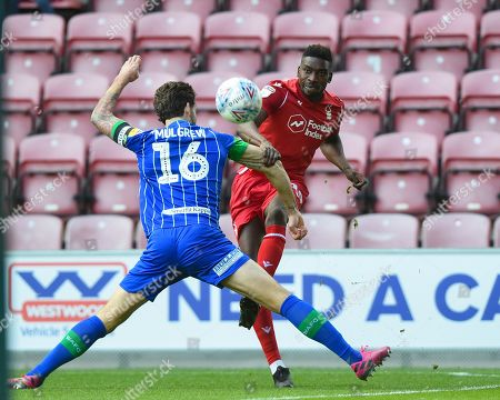 20th October 2019, DW Stadium, Wigan, England; Sky Bet Championship, Wigan Athletic v Nottingham Forest : Sammy Ameobi (19) of Nottingham Forest puts the cross in ahead of Charlie Mulgrew (16) of Wigan Athletic 