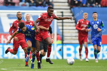20th October 2019, DW Stadium, Wigan, England; Sky Bet Championship, Wigan Athletic v Nottingham Forest : Sammy Ameobi (19) of Nottingham Forest is challenged by Antonee Robinson (3) of Wigan Athletic  Credit: Richard Long/News Images
