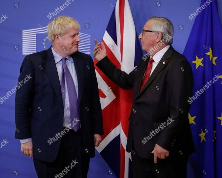 President of the European Commission Jean-Claude Juncker (R) and British Prime Minister Boris Johnson shake hands during a press conference on the Brexit deal in Brussels, Belgium, 17 October 2019. According to reports, the EU and the British government have reached a deal for Brexit.