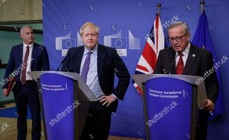 President of the European Comission Jean-Claude Juncker (R), British Prime Minister Boris Johnson (C) and Brexit Secretary Stephen Barclay (L) during a press conference on the Brexit deal in Brussels, Belgium, 17 October 2019. According to reports, the EU and the British government have reached a deal for Brexit.