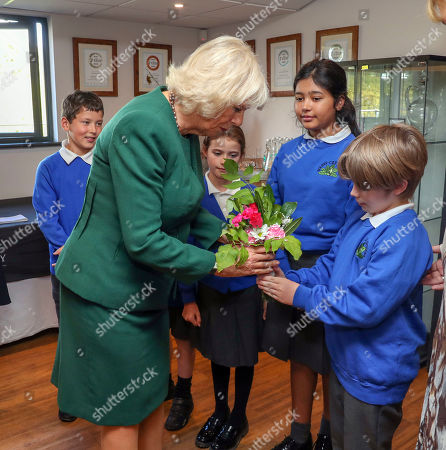 Camilla Duchess of Cornwall, President of Wine GB, receives flowers from children from Bolney Primary school during a visit to the new Winery at Bolney Wine Estate in Haywards Heath, Sussex