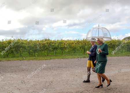 Camilla Duchess of Cornwall, President of Wine GB, (right) with Sam Linter, Managing Director and chief wine maker during a visit to the Bolney Wine Estate in Haywards Heath, Sussex