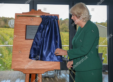 Camilla Duchess of Cornwall, President of Wine GB, unveils a plaque during a visit to the new winery at Bolney Wine Estate in Haywards Heath, Sussex,