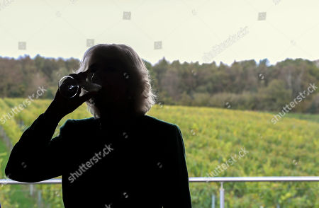 Camilla Duchess of Cornwall, President of Wine GB, participates in some wine tasting during a visit to the new winery at Bolney Wine Estate in Haywards Heath, Sussex,
