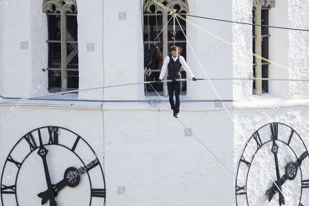 Jamie Redknapp, British TV host of the show 'A league of their own' and former football player, walks on a high wire from the clocktower to the castle in Thun, 17 October 2019, in Thun, Switzerland.