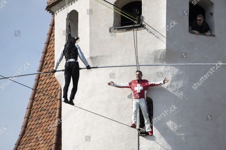 Swiss high wire artist Freddy Nock (R) congratulates Jamie Redknapp, British TV host of the show 'A league of their own' and former football player, after completing a high wire walk from the clocktower to the castle in Thun, 17 October 2019, in Thun, Switzerland.