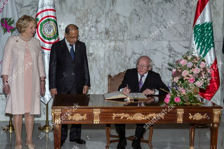 Lebanese President Michel Aoun (C) and Irish First lady Sabina Higgins (L) look at Irish President Michael Higgins (R) writing in the guest book at the presidential palace in Baabda, east of Beirut, Lebanon, 17 October 2019. Irish President Michael Higgins arrived with his wife for an official visit to Lebanon on the evening of 16 October 2019.