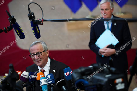 Stock Image of European Commission President Jean-Claude Juncker, left, talks to journalists next to European Union chief Brexit negotiator Michel Barnier as they arrive for an EU summit at the Europa building in Brussels, . Britain and the European Union reached a new tentative Brexit deal on Thursday, hoping to finally escape the acrimony, divisions and frustration of their three-year divorce battle