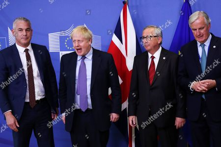 Britain's Brexit Secretary Stephen Barclay, British Prime Minister Boris Johnson, European Commission President Jean-Claude Juncker and European Union chief Brexit negotiator Michel Barnier, from left, pose for a photo during a press point at EU headquarters in Brussels, . Britain and the European Union reached a new tentative Brexit deal on Thursday, hoping to finally escape the acrimony, divisions and frustration of their three-year divorce battle