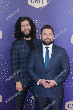 Stock Picture of Dan and Shay, Shay Mooney, Dan Smyers. Dan Smyers, left, and Shay Mooney of Dan and Shay arrive at 2019 CMT Artists of the Year at Schermerhorn Symphony Center, in Nashville, Tenn