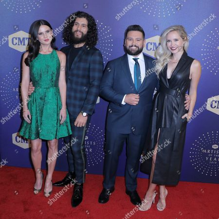 Stock Image of Dan and Shay, Shay Mooney, Dan Smyers, Abby Law, Hannah Billingsley. Dan Smyers, second from left, with his wife, Abby Law, and Shay Mooney with his wife, Hannah Billingsley, of Dan and Shay arrive at 2019 CMT Artists of the Year at Schermerhorn Symphony Center, in Nashville, Tenn