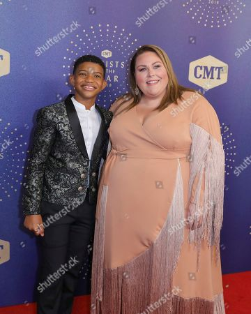 Stock Photo of Lonnie Chavis, Chrissy Metz. Lonnie Chavis, left and Chrissy Metz arrive at 2019 CMT Artists of the Year at Schermerhorn Symphony Center, in Nashville, Tenn