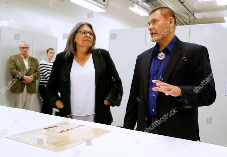 """Chief Beverly Kiohawiton Cook, Chief Eric Tehoroniathe Thompson. Chief Beverly Kiohawiton Cook, left, and Chief Eric Tehoroniathe Thompson, right, of the St. Regis Band of Mohawk Indians view the 1784 Treaty of Fort Stanwix at the Smithsonian's National Museum of the American Indian on in Washington. The treaty, on loan from the National Archives, was signed Oct. 22, 1784, at Fort Stanwix near present-day Rye, New York. It goes on view today in the exhibition """"Nation to Nation: Treaties Between the United States and American Indian Nations"""