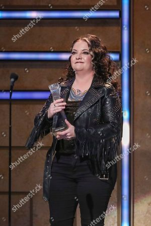 Stock Photo of Ashley McBryde accepts her Breakout Artist of the Year Award at 2019 CMT Artists of the Year at Schermerhorn Symphony Center, in Nashville, Tenn