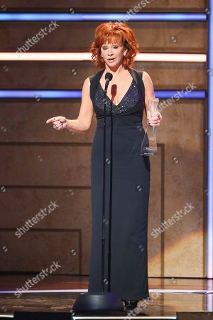 Stock Picture of Reba McEntire accepts her Artist of a Lifetime Award at 2019 CMT Artists of the Year at Schermerhorn Symphony Center, in Nashville, Tenn