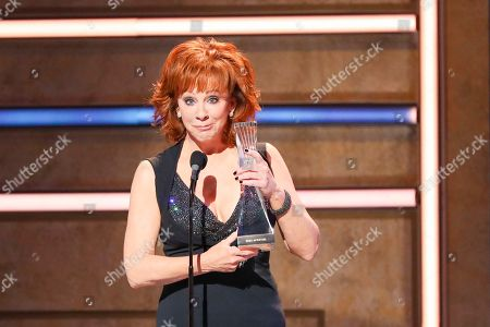 Reba McEntire accepts her Artist of a Lifetime Award at 2019 CMT Artists of the Year at Schermerhorn Symphony Center, in Nashville, Tenn