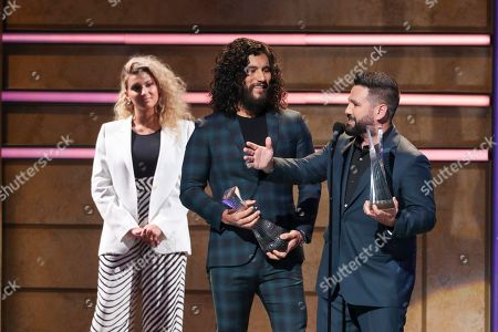 Tori Kelly, Dan Smyers, Shay Mooney, Dan and Shay. Dan Smyers, center and Shay Mooney of Dan and Shay accept the Artist of the Year award from Tori Kelly, left, at 2019 CMT Artists of the Year at Schermerhorn Symphony Center, in Nashville, Tenn