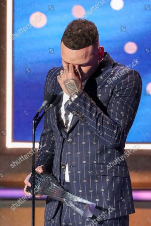 Stock Picture of Kane Brown accepts his Artist of the Year Award at 2019 CMT Artists of the Year at Schermerhorn Symphony Center, in Nashville, Tenn