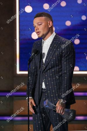 Stock Photo of Kane Brown accepts his Artist of the Year Award at 2019 CMT Artists of the Year at Schermerhorn Symphony Center, in Nashville, Tenn