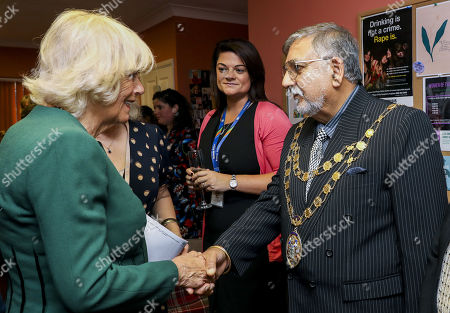 Stock Picture of Camilla Duchess of Cornwall meets Mayor of Crawley Raj Sharma during a visit to the Rape Crisis Centre for Surrey and Sussex on October 17, 2019 in Crawley, United Kingdom. The visit marks the 10th year anniversary since the Duchess first visited the Rape Crisis Centre in South London based in Croydon in November 2009.